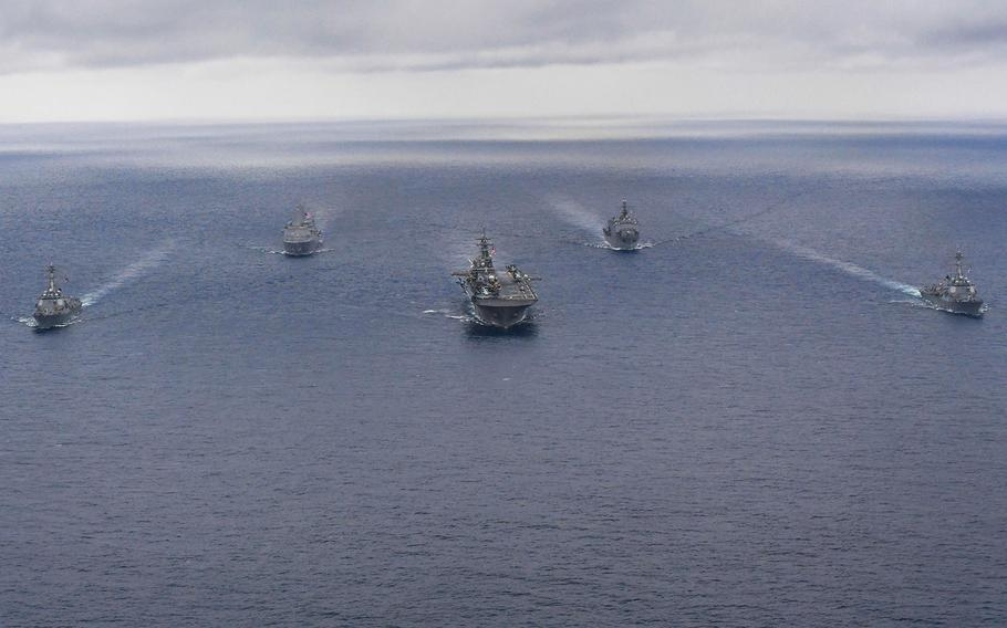 The USS Wasp strike group, which includes the USS Dewey, from left, the USS Green Bay, the USS Wasp, the USS Ashland and the USS Sterett, steams in formation in the Philippine Sea, April 17, 2018.