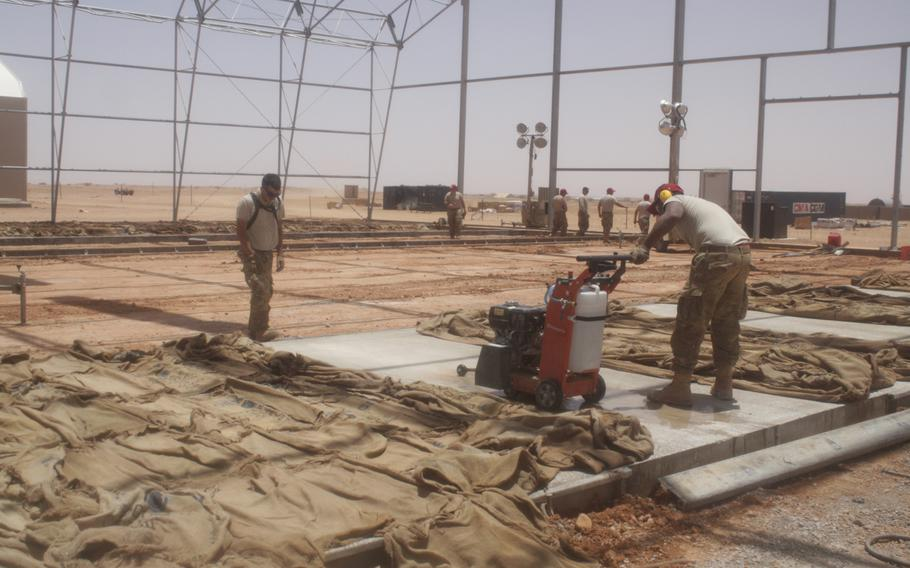 Airmen work in the unmanned aerial device apron in Agadez, Niger, where drones will be parked when they are not in operation.