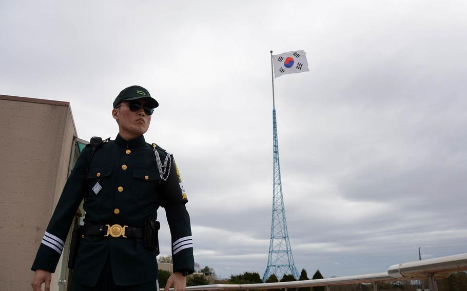 A member of the United Nations Command security force stands guard with the South Korean flag flying behind him in the village of Taesong-dong, Tuesday, April 24, 2018. It is the only place where civilians live in the Demilitarized Zone.