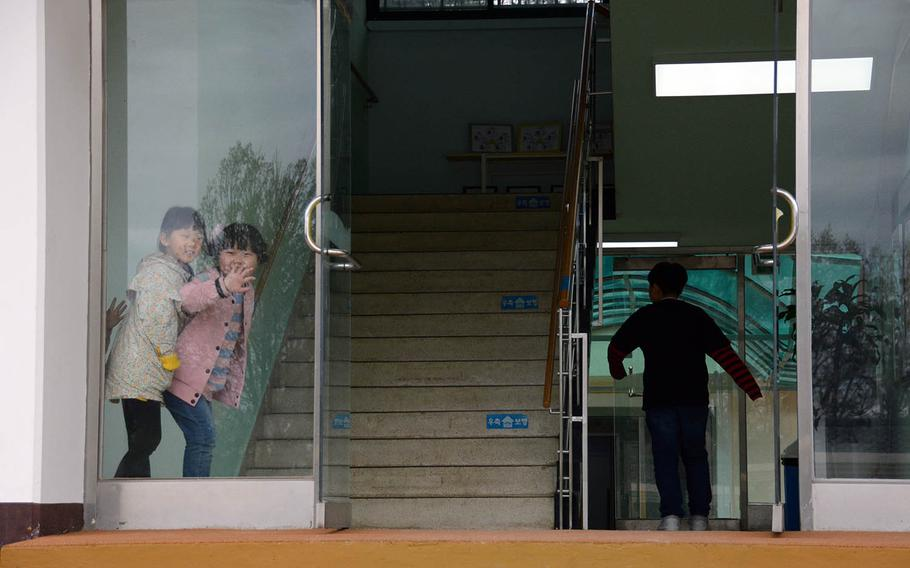 Children play in a doorway at the elementary school in the South Korean farming hamlet of Taesong-dong, which the military calls Freedom Village, Tuesday, April 24, 2018.