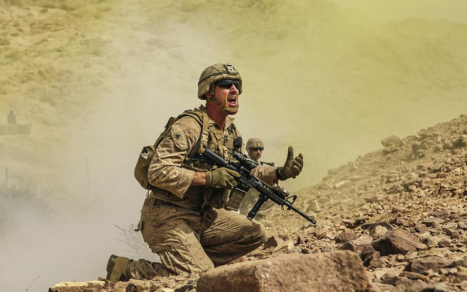 U.S. Marine Corps Sgt. Sean O'Neil, a squad leader assigned to Fox Company, Battalion Landing Team, 2nd Battalion, 6th Marine Regiment, 26th Marine Expeditionary Unit, directs his squad's movement during live-fire training in Jordan as part of Eager Lion 2018, Saturday, April 21, 2018.