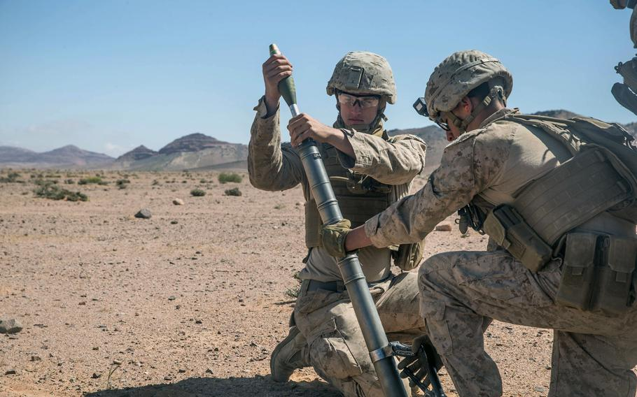 U.S. Marines assigned to Fox Company, Battalion Landing Team, 2nd Battalion, 6th Marine Regiment, 26th Marine Expeditionary Unit, prepare to fire an M224A1 60MM mortar system during Eager Lion training operations in Jordan, Sunday, April 22, 2018.