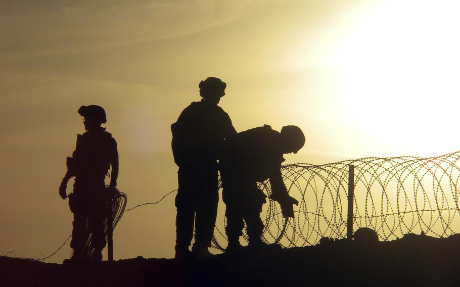 A Navy Seabee helps install concertina wire at an undisclosed area in this State Department photo from Monday, December 20, 2010.