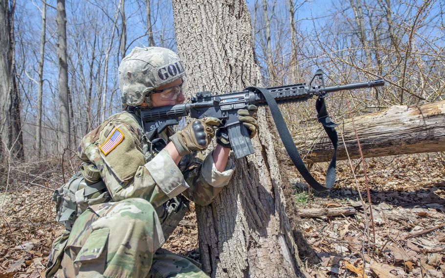 U.S. Military Academy Cadet Taylor England fires her M4 carbine rifle at a target during the Sandhurst Military Skills Competition at West Point, N.Y., April 14, 2018. England, the top-ranked cadet who is branching infantry, plans to serve with the 173rd Airborne Brigade when she completes the Infantry Basic Officer Leader course.