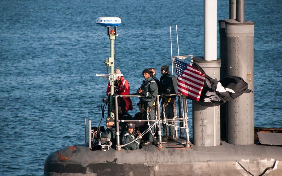 The fast-attack submarine USS Jimmy Carter flies the Jolly Roger in September.