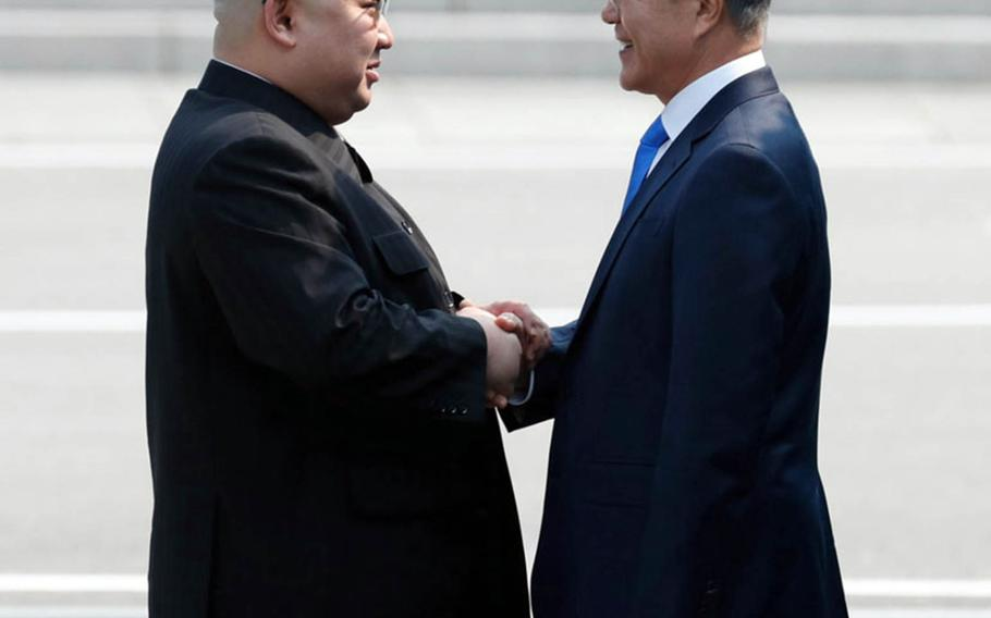 North Korean leader Kim Jong Un, left, greets South Korean President Moon Jae-in at the Joint Security Area of the Demilitarized Zone, Friday, April 27, 2018.