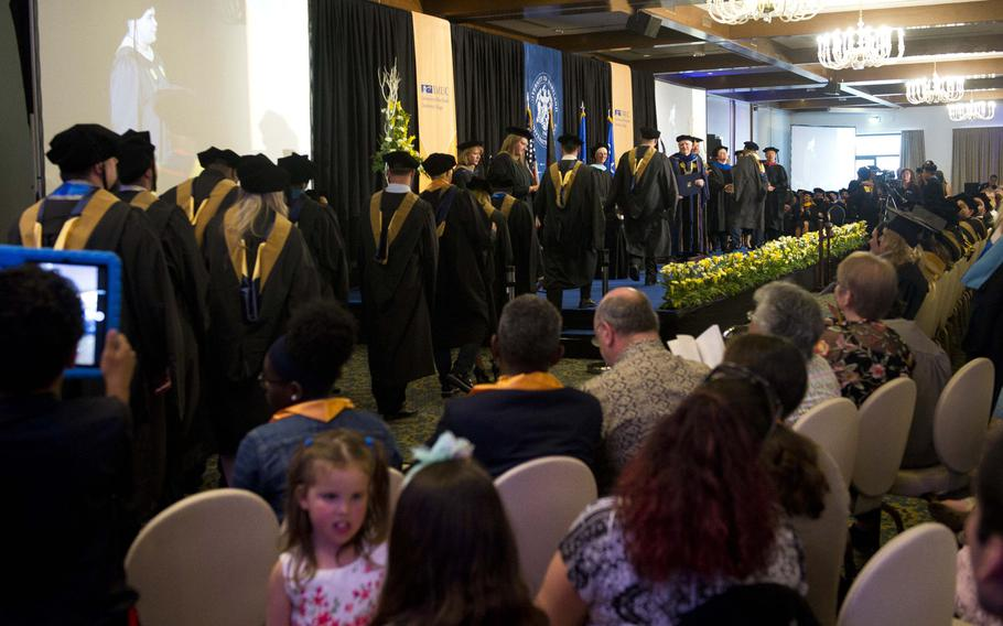 University of Maryland University College Europe graduates take the stage during the commencement ceremony at Ramstein Air Base, Germany, on Saturday, April 28, 2018. About 277 graduates participated in this year's ceremony.