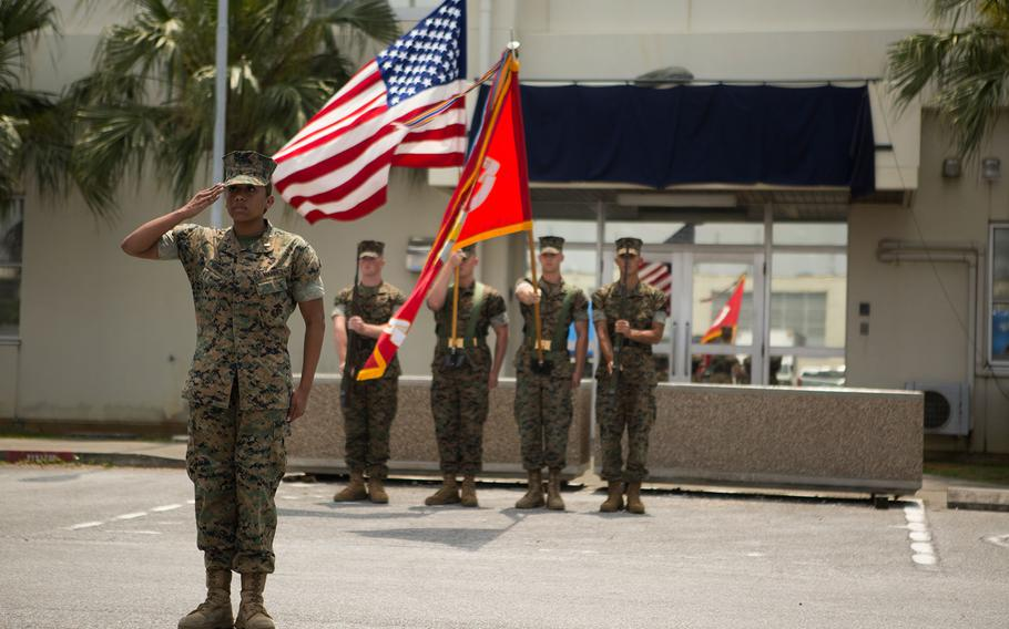 A Marine Corps color guard salutes during the Hauge Hall dedication ceremony at Camp Kinser, Okinawa, April 30, 2018.