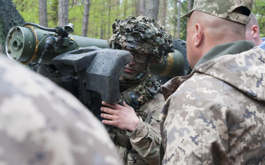 A soldier demonstrates how to use the Javelin antitank missile system as a delegation of Ukrainian military officials observes at at Hohenfels Training Area, Germany on May 9, 2017.  The U.S. has delivered antitank missiles to Ukraine, the first shipment of lethal aid to the country.