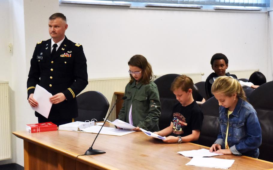 The defense team representing Luke Skywalker in a mock trial in Vilseck, Germany, Tuesday, May 1, 2018. Capt. Benjamin Hewett, left, helped fourth-graders Mackenzie Peikert and Ava Langbein defend Ethan Bettis, who portrayed Skywalker.