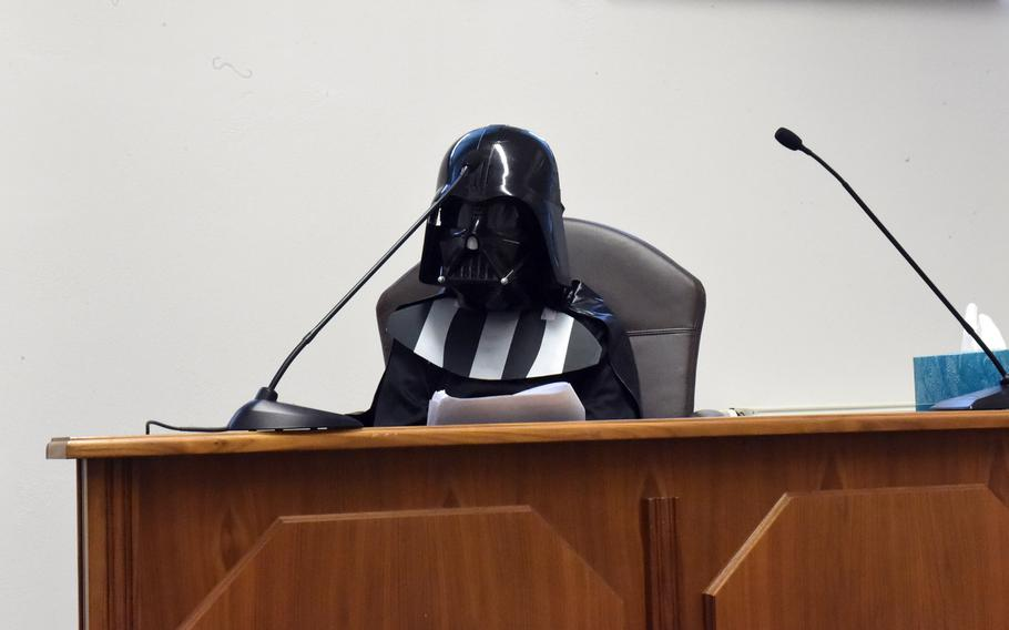 Darth Vader, played by fourth-grader Xavier Maul, on the witness stand at a mock trial in Vilseck, Germany, Tuesday, May 1, 2018.