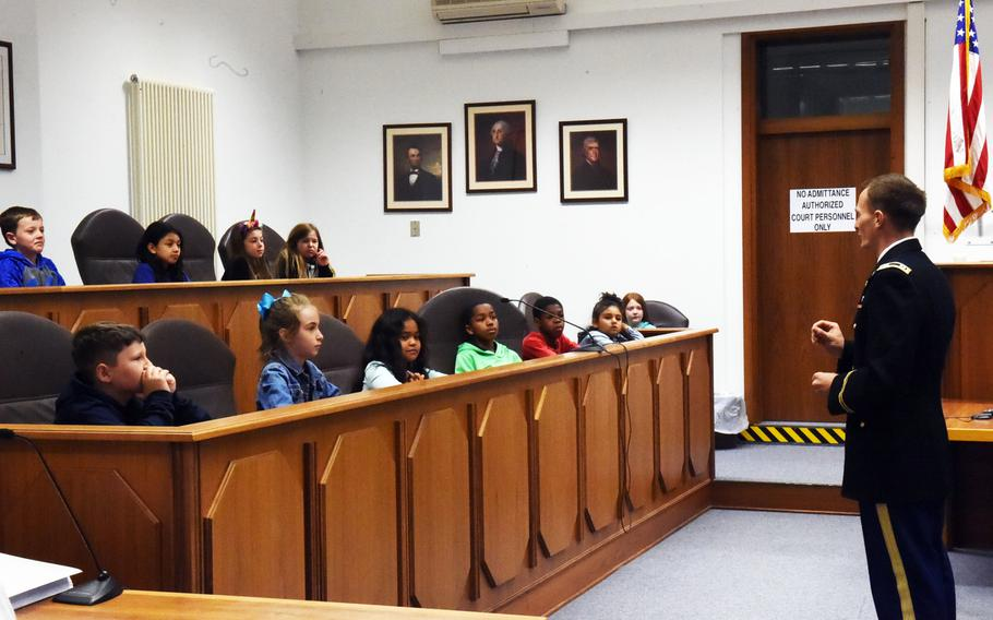 Capt. Brett Grantham makes his opening remarks to the fourth-grade jury at the mock trial of Luke Skywalker, Tuesday, May 1, 2018, at Vilseck, Germany.