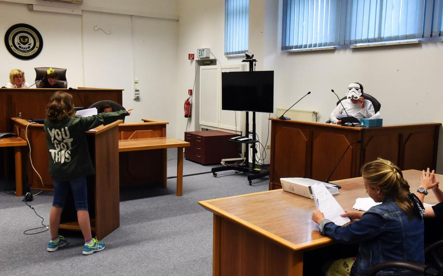 A Stormtrooper, played by fourth-grader Bobby Silva, is cross-examined by the defense during the mock trial of Luke Skywalker in Vilseck, Germany, Tuesday, May 1, 2018.