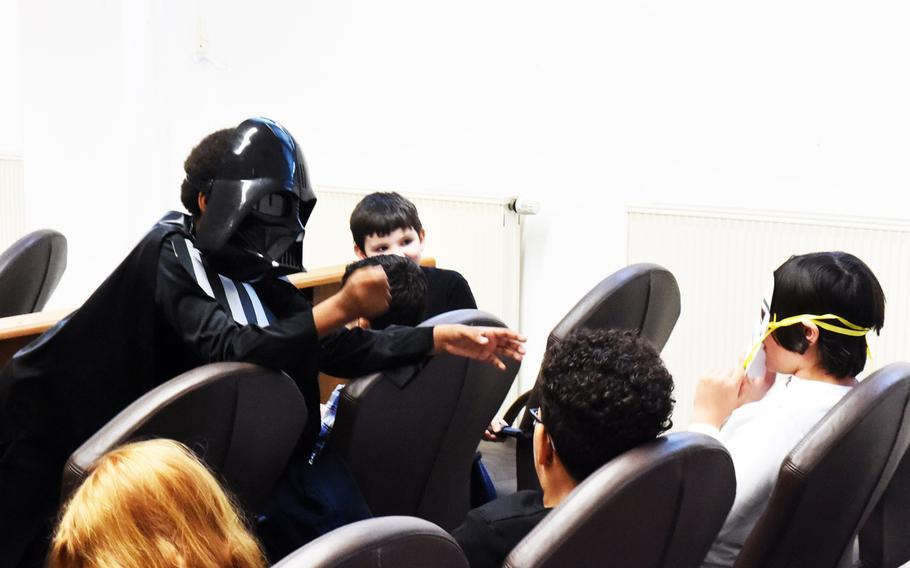 Darth Vader, played by fourth-grader Xavier Maul, upset at the not guilty verdict against Luke Skywalker, attempts to force-choke the witnesses, at a mock trial in Vilseck, Germany, Tuesday, May 1, 2018.