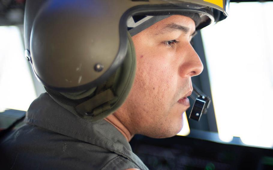 Petty Officer 1st Class Carlos Rivera, a landing craft air cushion, or LCAC, engineer, checks an instrument while training near Sasebo Naval Base, Japan, April 19, 2018.
