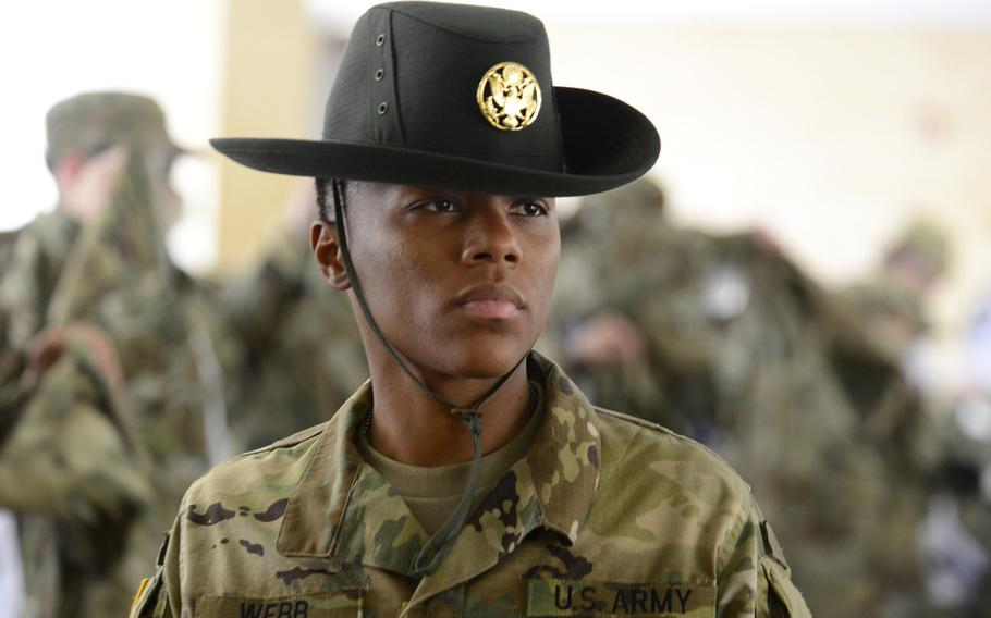 Drill Sergeant Andrea Webb surveys the new arrivals on the  day recruits arrive at 1st Battalion, 79th Field Artillery, Fort Sill, Okla., March 9, 2016. Webb volunteered to become a drill sergeant because her own drill sergeant made a big impression on her in basic combat training.