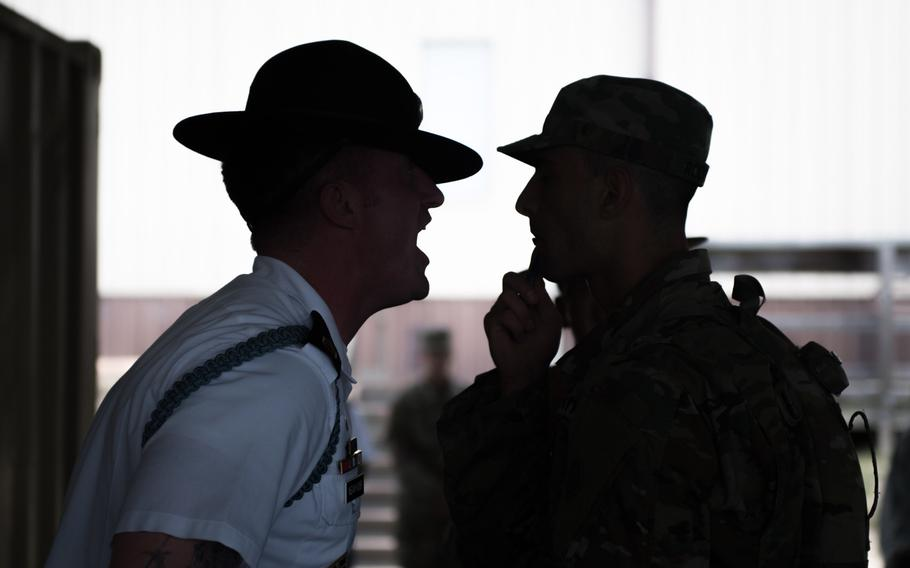 """A U.S. Army drill sergeant  participates in the """"Shark Attack"""" or fear stage of the discipline process, as trainees arrive to the first day of Basic Combat Training on June 12, 2017, at Fort Jackson, S.C."""