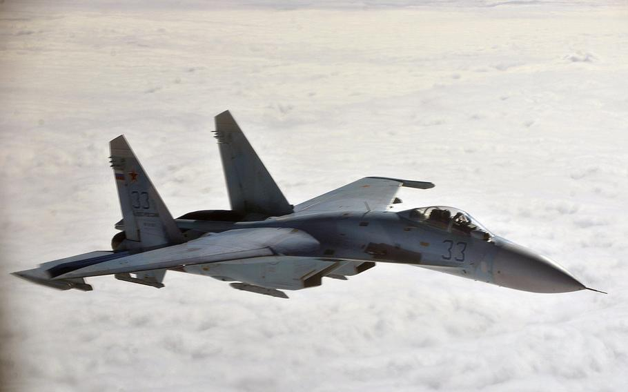 A Russian Su-27 flies near Alaska in 2013. Russia's military spending fell for the first time since 1998, according to a report by the Stockholm International Peace Research Institute.