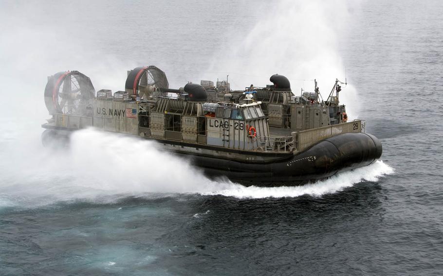 A landing craft air cushion, or LCAC, assigned to Naval Beach Unit 7 disembarks the amphibious-assault ship USS Bonhomme Richard last month near Sasebo Naval Base, Japan.