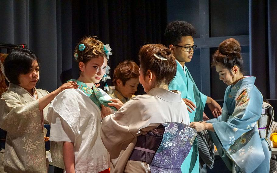 Students don traditional Japanese kimono with help from local volunteers during Asian-Pacific Day at Yokota High School at Yokota Air Base, Japan, Thursday, May 3, 2018.