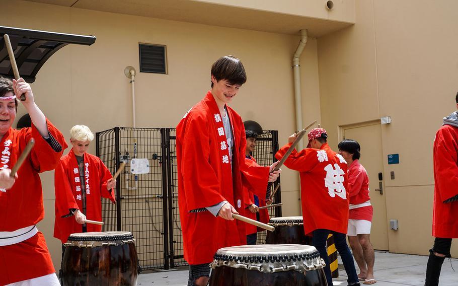 A Yokota High student smiles while playing a taiko during Asia-Pacific Day, Thursday, May 3, 2018, at Yokota Air Base, Japan.
