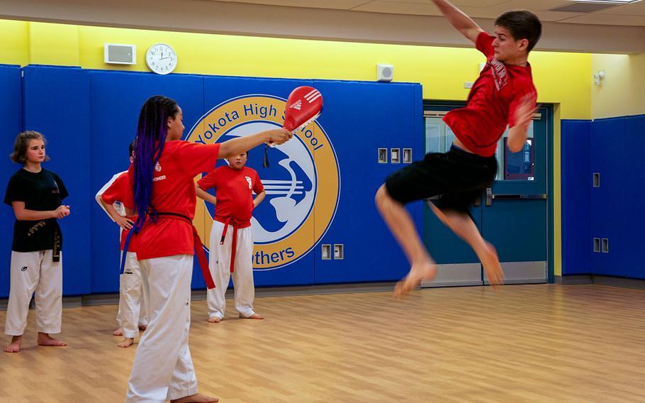 Austin Fisher, a sophomore at Yokota High School, Japan, demonstrates taekwondo during Asia-Pacific Day, Thursday, May 3, 2018.