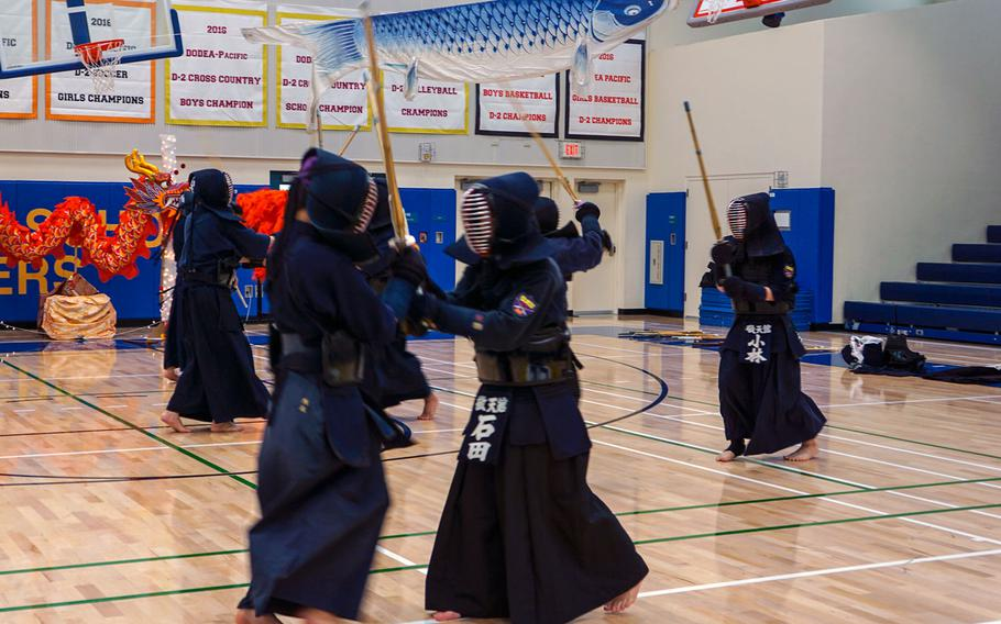 Yokota High School students try the traditional Japanese martial art of kendo during Asia-Pacific Day, Thursday, May 3, 2018.