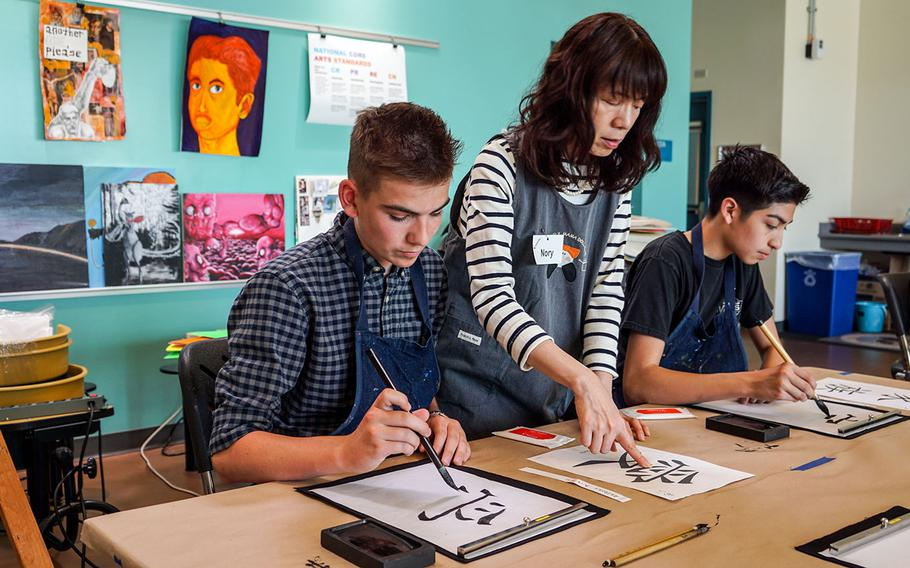 High School students learn Japanese calligraphy during Asia-Pacific Day, Thursday, May 3, 2018, at Yokota Air Base, Japan.