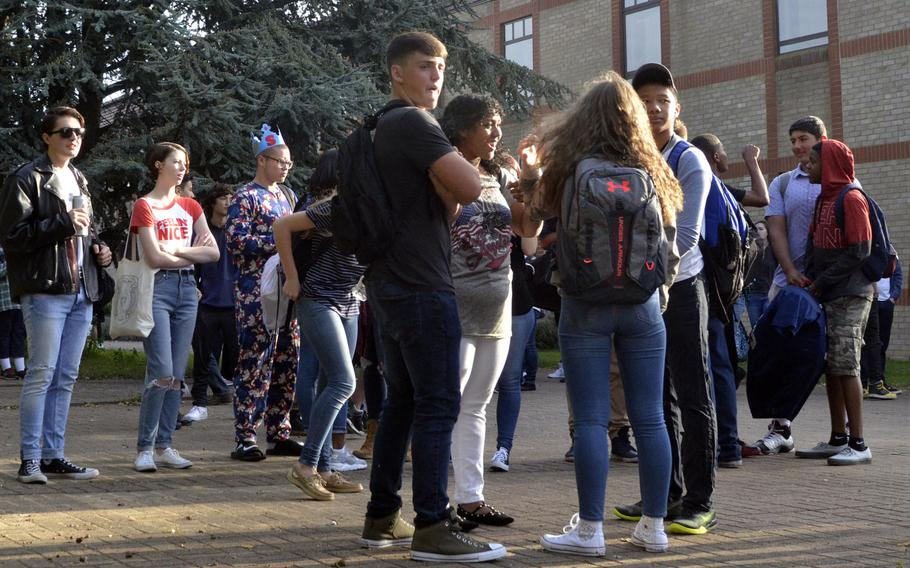 Teenagers gather outside their Defense Department school on the first day of school last year. A community forum geared toward providing parents and teachers of teenagers with the tools to build emotional resiliency takes place on May 10 at Ramstein Middle School in Germany.
