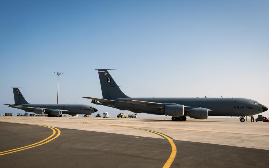 Two KC-135 Stratotankers sit on the runway at Camp Lemonnier, Djibouti, before a mission, Dec. 6, 2016.  U.S. military aircraft flying over Djibouti are being targeted by high-powered lasers launched from an area near China's military base in the east African country, according to the Federal Aviation Agency.
