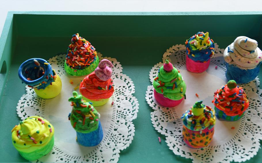 Ceramic cupcakes were among the works of art on display Thursday, May 3, 2018, during the opening night of the DODEA art exhibit at Kaiserslautern city hall in Germany.