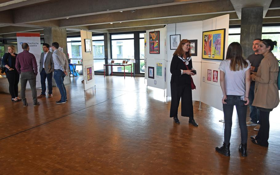 Visitors mingle at the opening night of the DODEA art exhibit on May 3, 2018, in Kaiserslautern, Germany. The show runs through the end of May at Kaiserslautern city hall.
