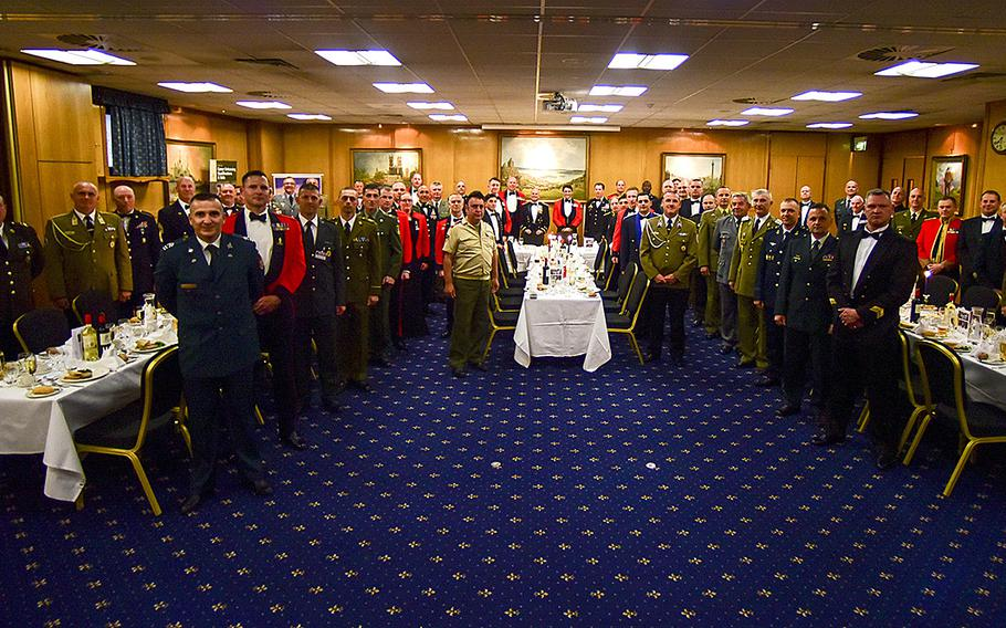 Top noncommissioned officers from across Europe and the U.S. gather before a formal British regimental dinner at the 12th annual Council of European Armies for Noncommissioned Officers, Thursday, May 3, 2018, in London. The three-day event focused on education, professionalism and developing relatively new NCO corps across the Continent.
