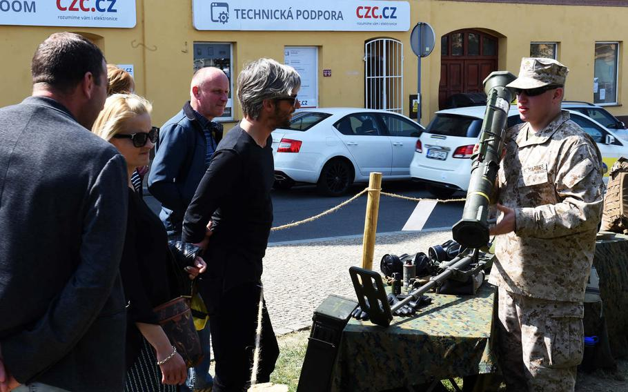 A Czech re-enactor shows a U.S. AT-4 rocket launcher during the a festival in Pilsen, Czech Republic, marking the liberation of the city from the Nazis, Friday, May 4, 2018.