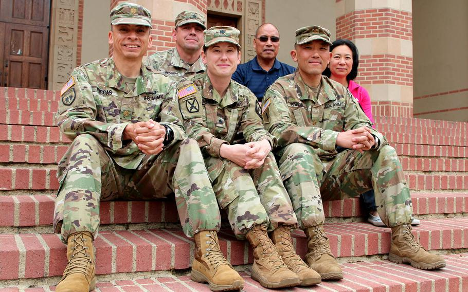 Six UCLA Army ROTC staff members helped to rescue motorists trapped in a fiery crash on the I-405 Freeway near campus. Front from left: Maj. Tyrone Vargas, UCLA assistant adjunct professor, Lt. Col. Shannon Stambersky,  UCLA professor of military science, Maj. Steve Kwon.Rear from left: Sgt. 1st Class Rhu Maggio, military instructor, Romeo Miguel, recruiting operations officer, Victoria Sanelli, manager of UCLA Army ROTC.