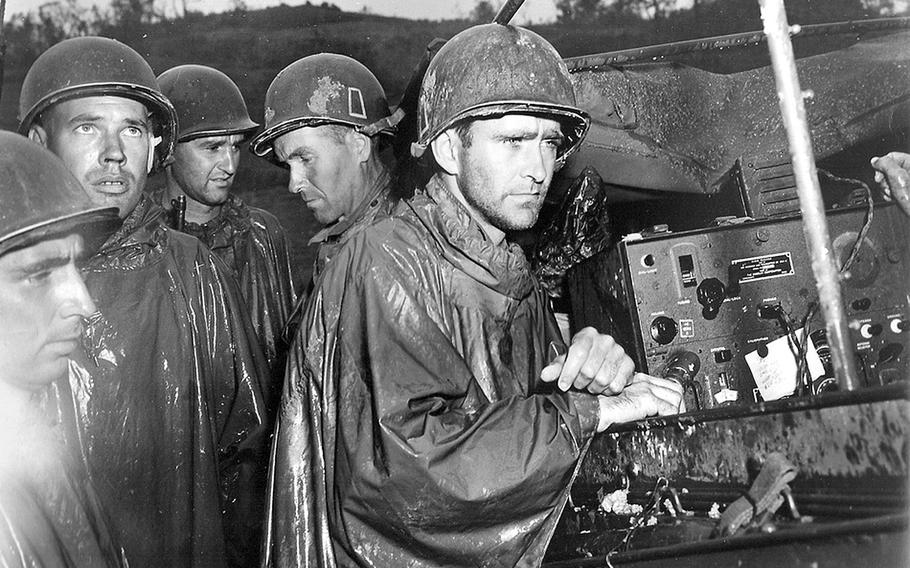A group of soldiers take a break from fighting in Okinawa to listen to reports of Germany's surrender on May 8, 1945. Moments after the announcement, the men returned to the fighting against the Japanese. The American Soldier in WWII, a history project directed from Virginia Tech, is converting microfilm of surveys from WWII soldiers into a searchable internet database.