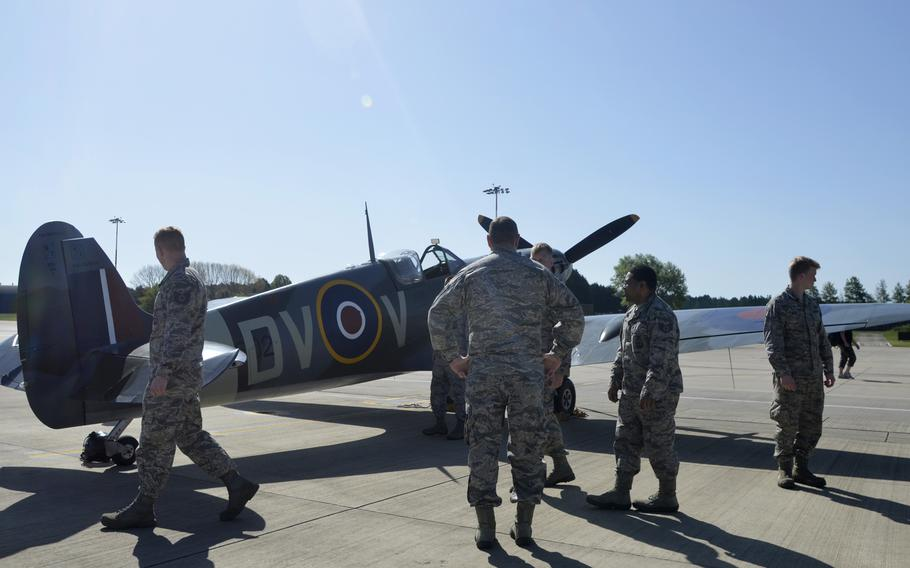 Airmen inspect a Supermarine Spitfire from the Imperial War Museum Duxford during a wing heritage fundraising event hosted by the 492nd Fighter Squadron at RAF Lakenheath, England, Monday, May 7, 2018. The event raised money for the Air Force Assistance Fund, which provides emergency support to Air Force active duty, retirees, reservists, guard and dependents.