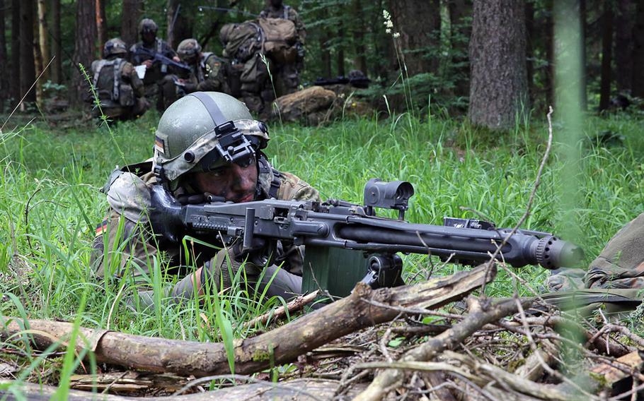 A German army soldier provides security while conducting a patrol during a training exercise at the Hohenfels Training Area, Germany, Jun. 21, 2016. German troops are reportedly short on the basics: body armor, night vision gear and cold-weather clothing.