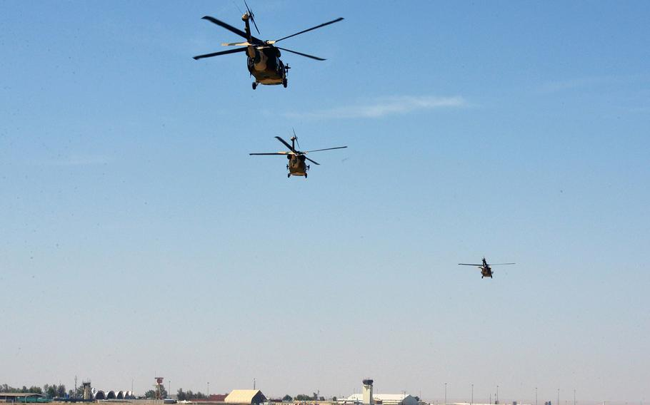 Three UH-60 Black Hawks take off to conduct the first Afghan-led operational mission on this aircraft May 8, 2018, Kandahar Air Field, Afghanistan. The mission, which was in support of the elections, occurred just one day after the crews graduated from Mission Qualification Training.