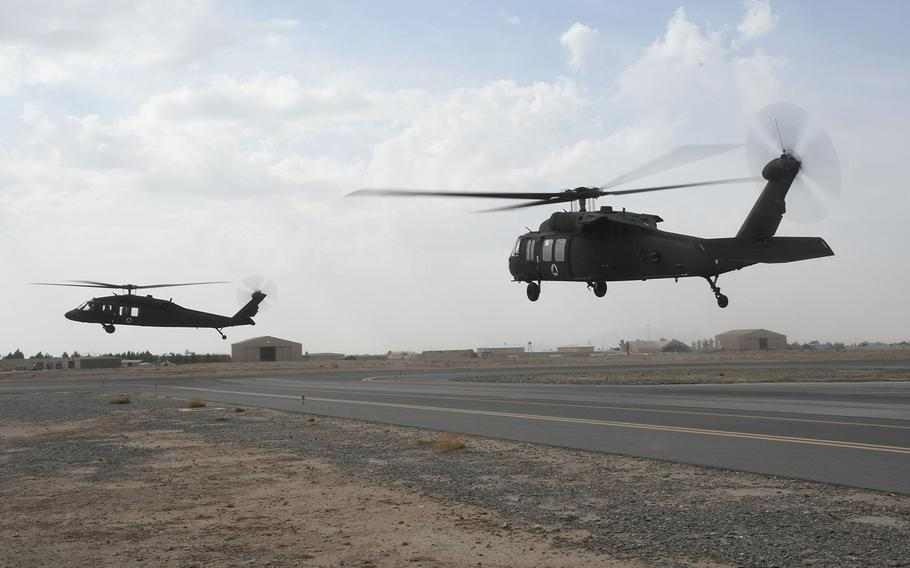 Afghan pilots learning to operate the UH-60 Black Hawk fly in the aircraft for the first time with U.S. contractors at Kandahar Air Field in March. Three UH-60s conducted the first Afghan-led operational mission on this aircraft May 8, 2018.