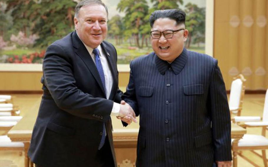 Secretary of State Mike Pompeo poses with North Korean leader Kim Jong Un in this photo published by the Rodong Sinmun newspaper, Thursday, May 10, 2018.