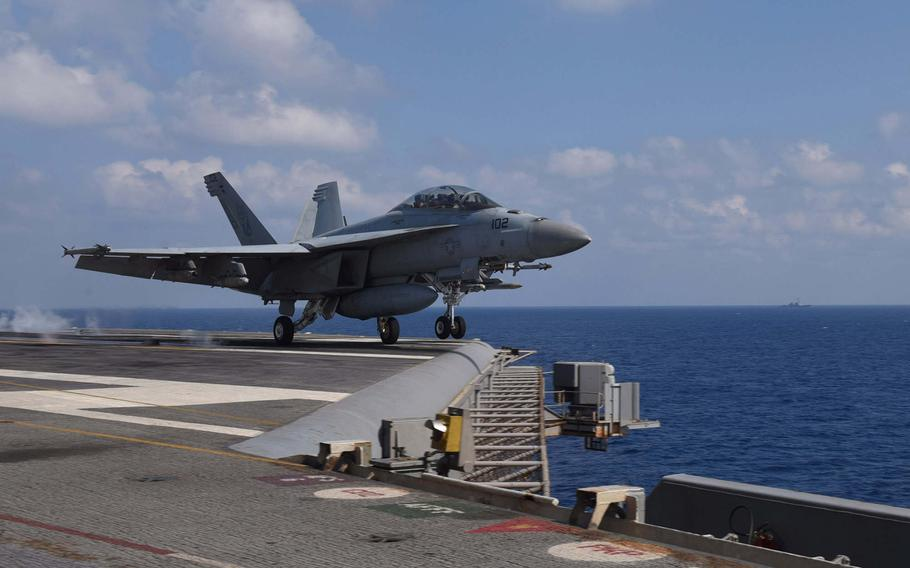 """An F/A-18F Super Hornet, assigned to the """"Red Rippers"""" of Strike Fighter Squadron VFA 11, launches from the flight deck aboard the aircraft carrier USS Harry S. Truman on May 8, 2018. The carrier is currently launching airstrikes against remnants of the ISIS militant group in Syria."""