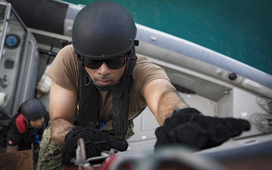 A sailor boards a vessel on May 2, 2018, near Souda Bay, Greece, as part of a practice raid during Phoenix Express, an exercise to improve international maritime policing in the Mediterranean Sea.