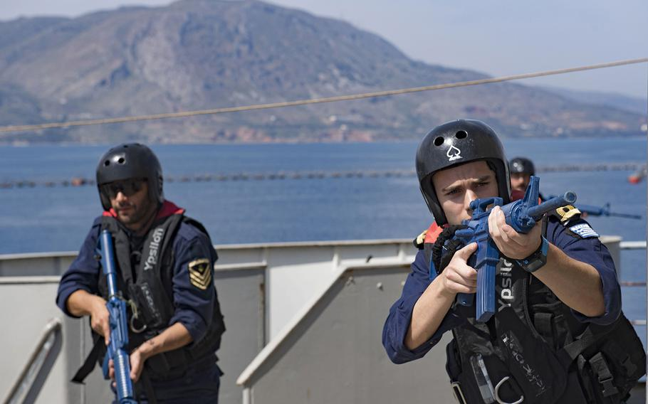 Greek sailors take part in a simulated raid on May 2, 2018, near Souda Bay, Greece, during Phoenix Express, an exercise to strengthen cooperative policing in the Mediterranean Sea.