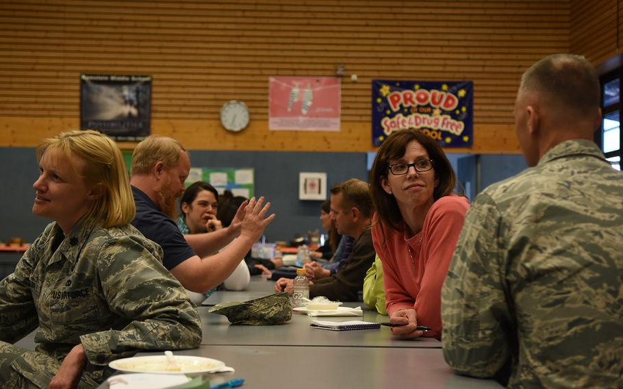 Victoria Barlow, right-center, participates in a discussion about emotional resilience for teenagers at a community forum Thursday, May 10, 2018, at Ramstein Middle School in Germany.