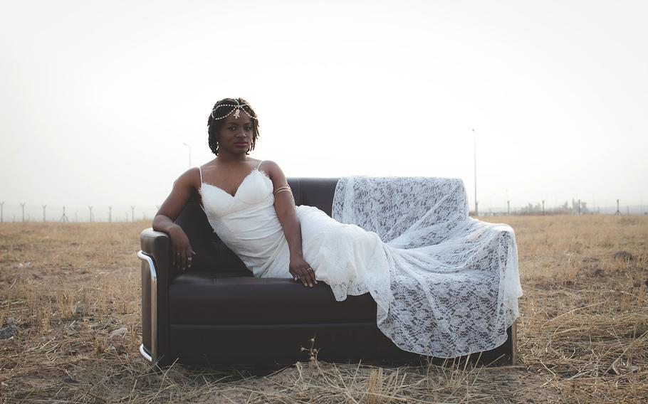 Texas Army National Guard Staff Sgt. Cillia Edwards, an intel analyst with the Texas Army National Guard, 1st Armored Division, poses for a bridal photoshoot during her deployment to Iraq, Jan. 16, 2017.