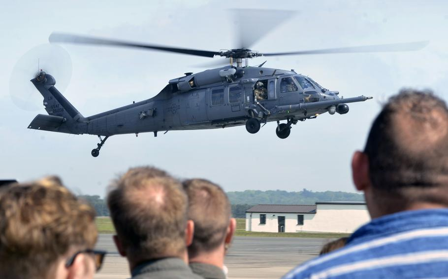 A crowd watches and bids farewell to an HH-60G Pave Hawk helicopter crew of the 56th Rescue Squadron as it flies from RAF Lakenheath, England, to its new duty station at Aviano Air Base, Italy, Tuesday, May 15, 2018.