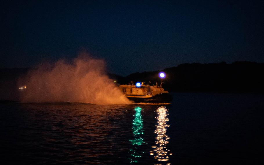 A landing craft air cushion, or LCAC, from Naval Beach Unit 7 returns from a night mission near Sasebo Naval Base, Japan, May 10, 2018.
