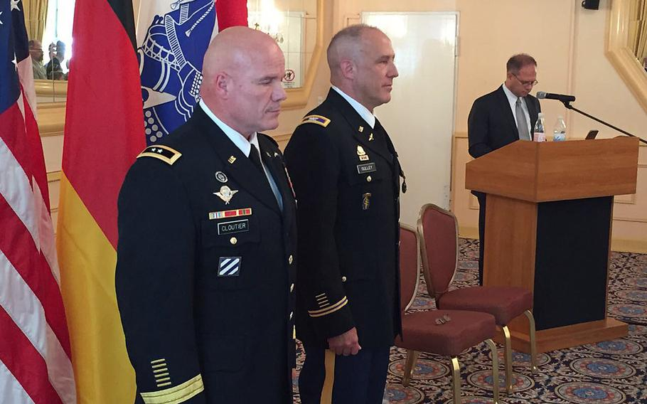 Maj. Gen. Roger Cloutier, U.S. Africa Command's chief of staff, left, stands with Col. Richard Gulley during Gulley's retirement ceremony June 30, 2017, in Stuttgart, Germany. Gulley, along with numerous other reservists, says he was unfairly targeted by Army investigators over housing benefits.