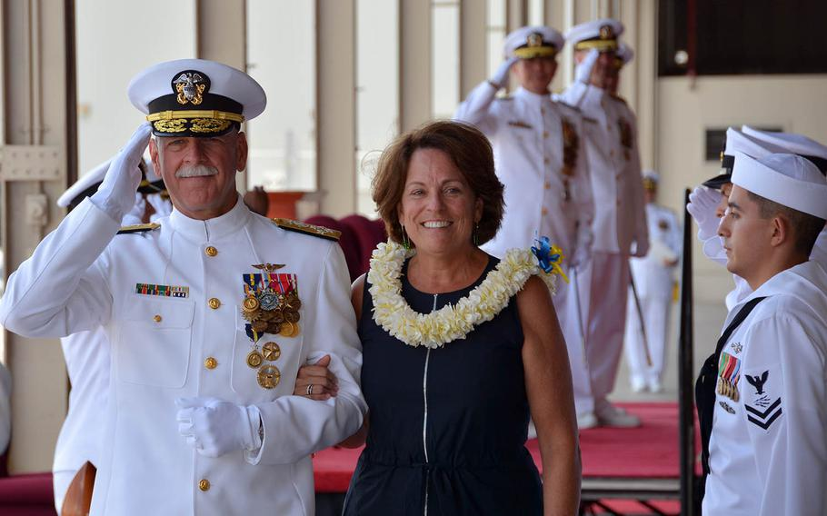 Adm. Scott Swift and his wife, Trish, depart a ceremony at Joint Base Pearl Harbor-Hickam, Hawaii, wherehe turned over command of U.S. Pacific Fleet to Adm. John Aquilino, May 17, 2018.